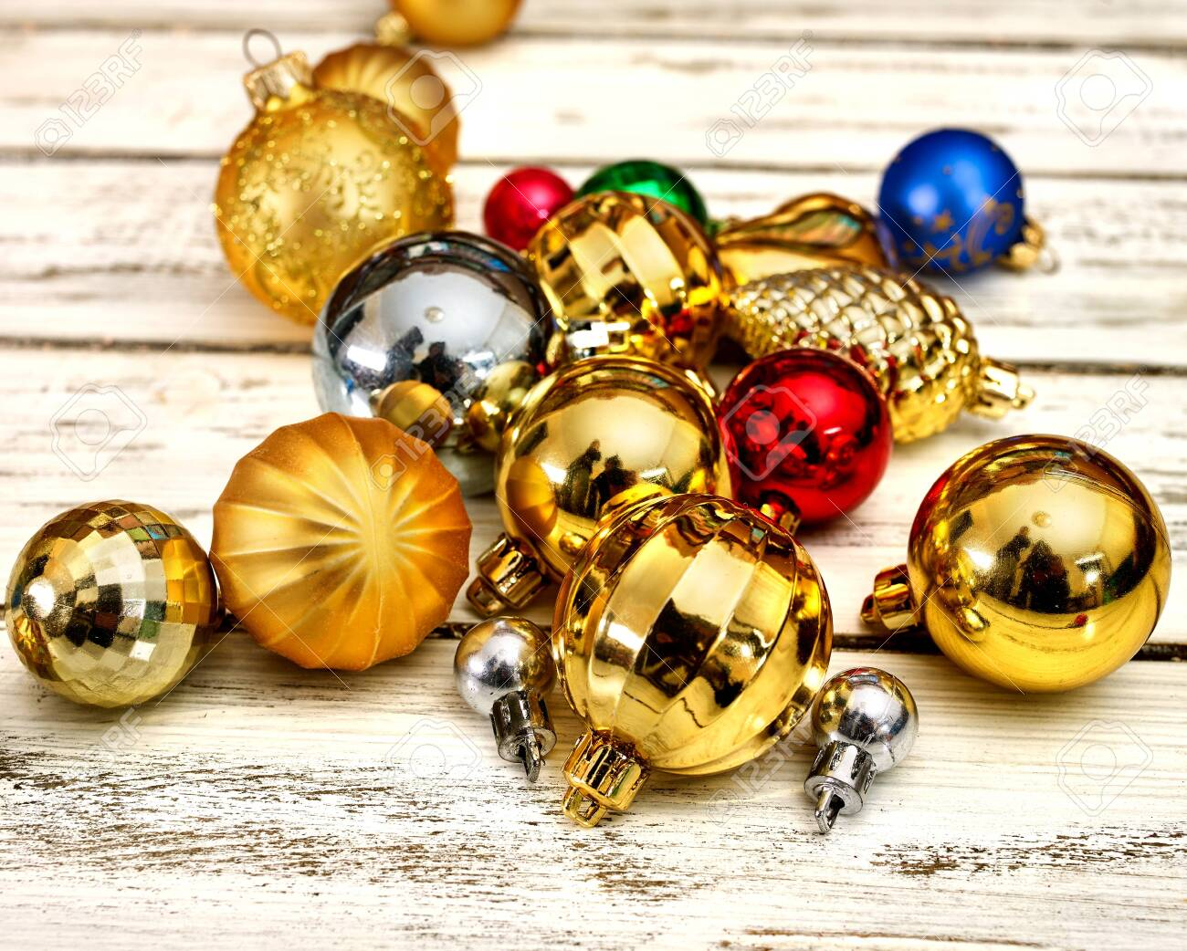 Christmas decorations design of Xmas group balls ornaments on white wooden boards . Square frame . - 133940067