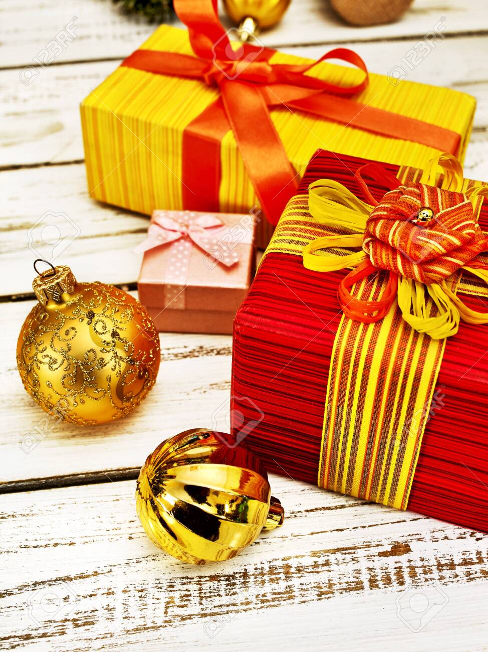 Christmas gift box , Xmas decorations and balls ornaments on white wooden table. Vertical frame . - 134846524