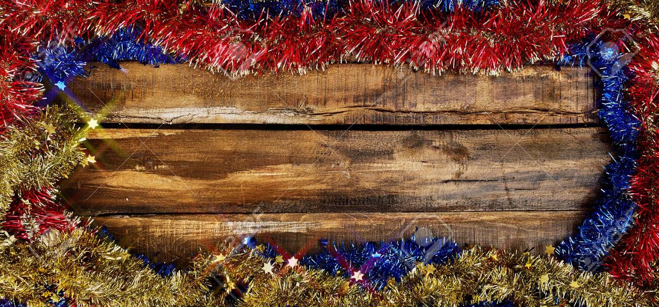 Christmas frame tinsel decorations with copy space from wooden boards. Top view horizontal long frame. - 134846526