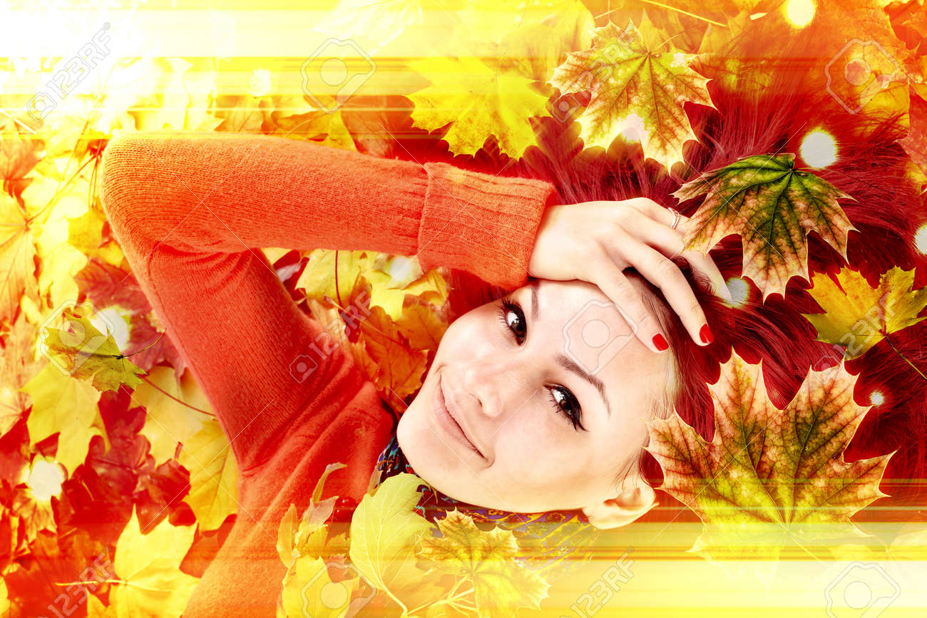 Autumn leaves light with girl. Beauty face of beautiful woman close. Fashion dream in red fall color outside. Happy person lights. - 157027211