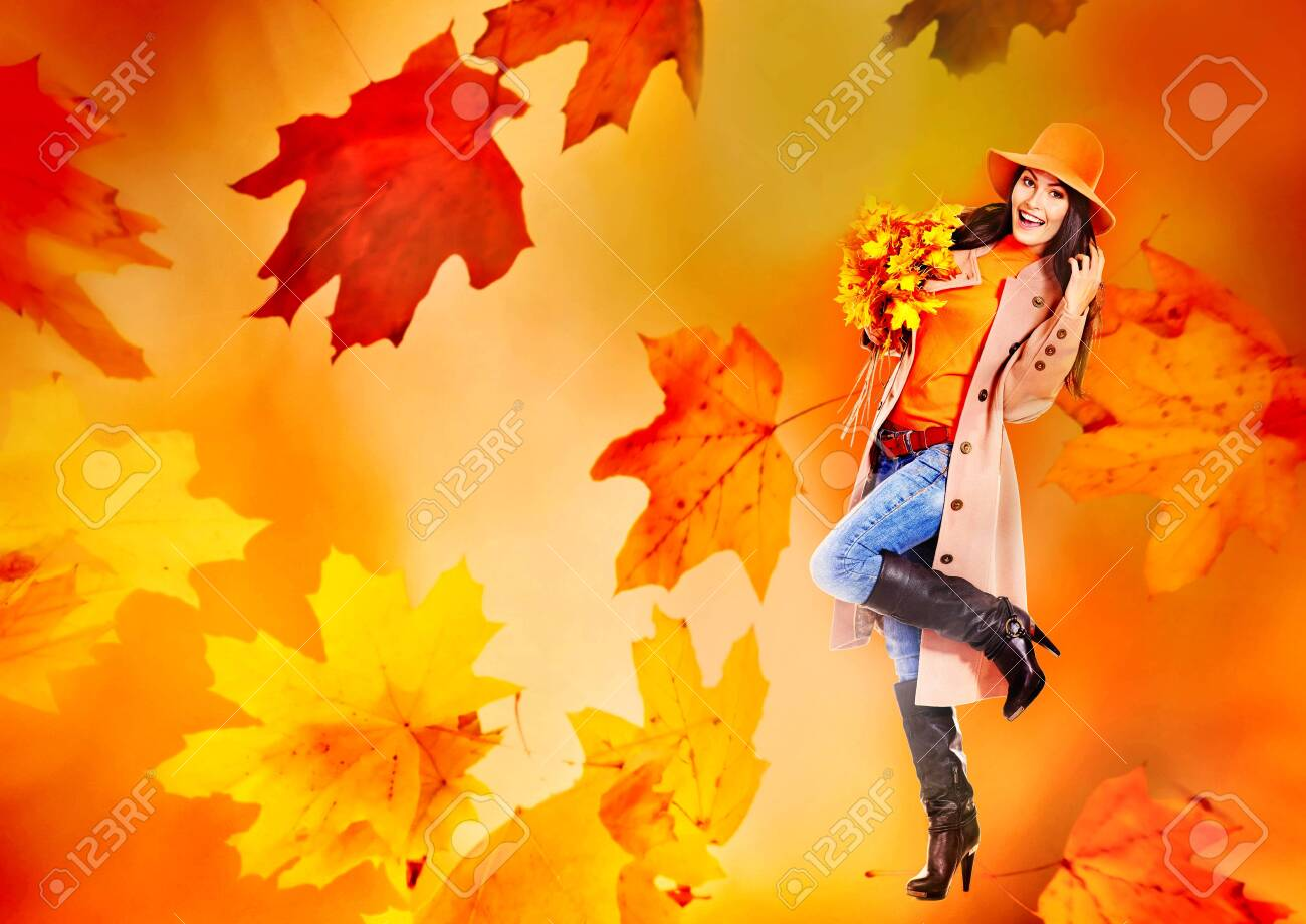 Autumn sale banners leaves background with beautiful woman wear in coat and hat, high heel boots. Girl holding maple bouquet in hand. - 157069374