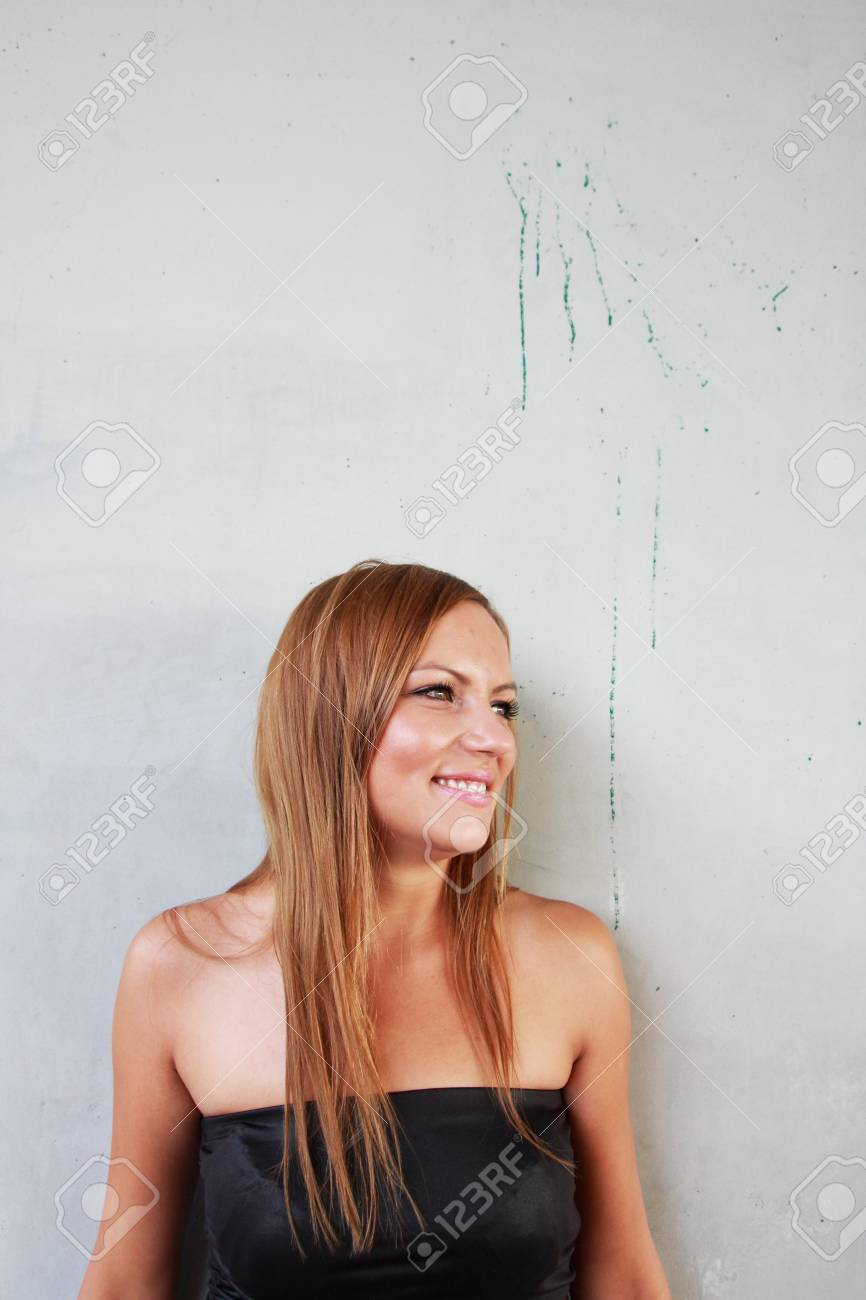 Portrait of young woman on the wall background Stock Photo - 10702949