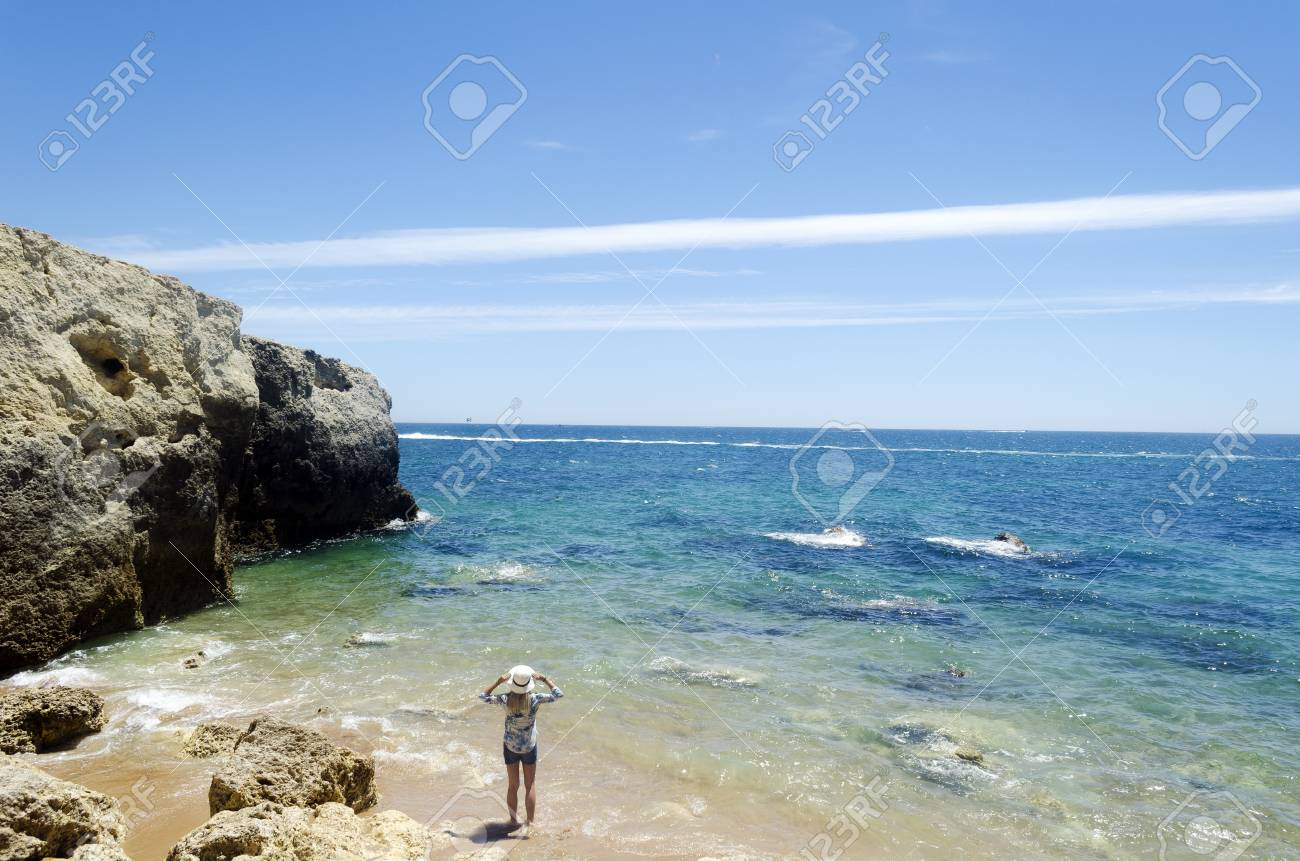 Woman standing at the beach Stock Photo - 21871539