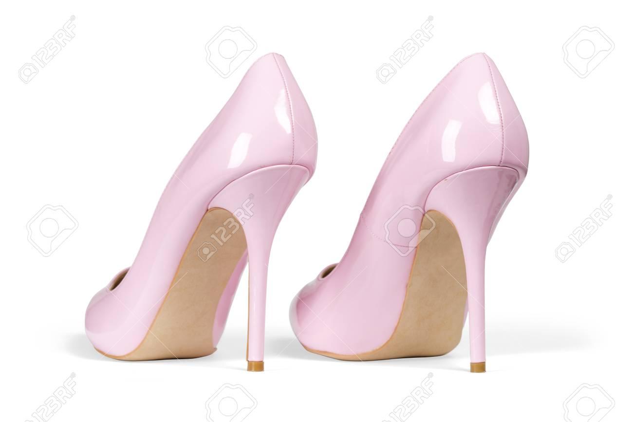 Une Paire De Chaussures Femmes Talon Rose Isolé Sur Fond