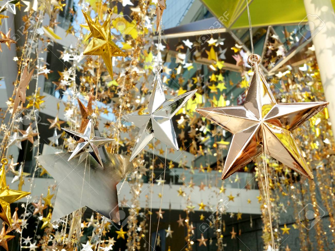 gold silver bronze stars decoration for merry christmas and happy new years stock photo - Decorating With Silver And Gold For Christmas