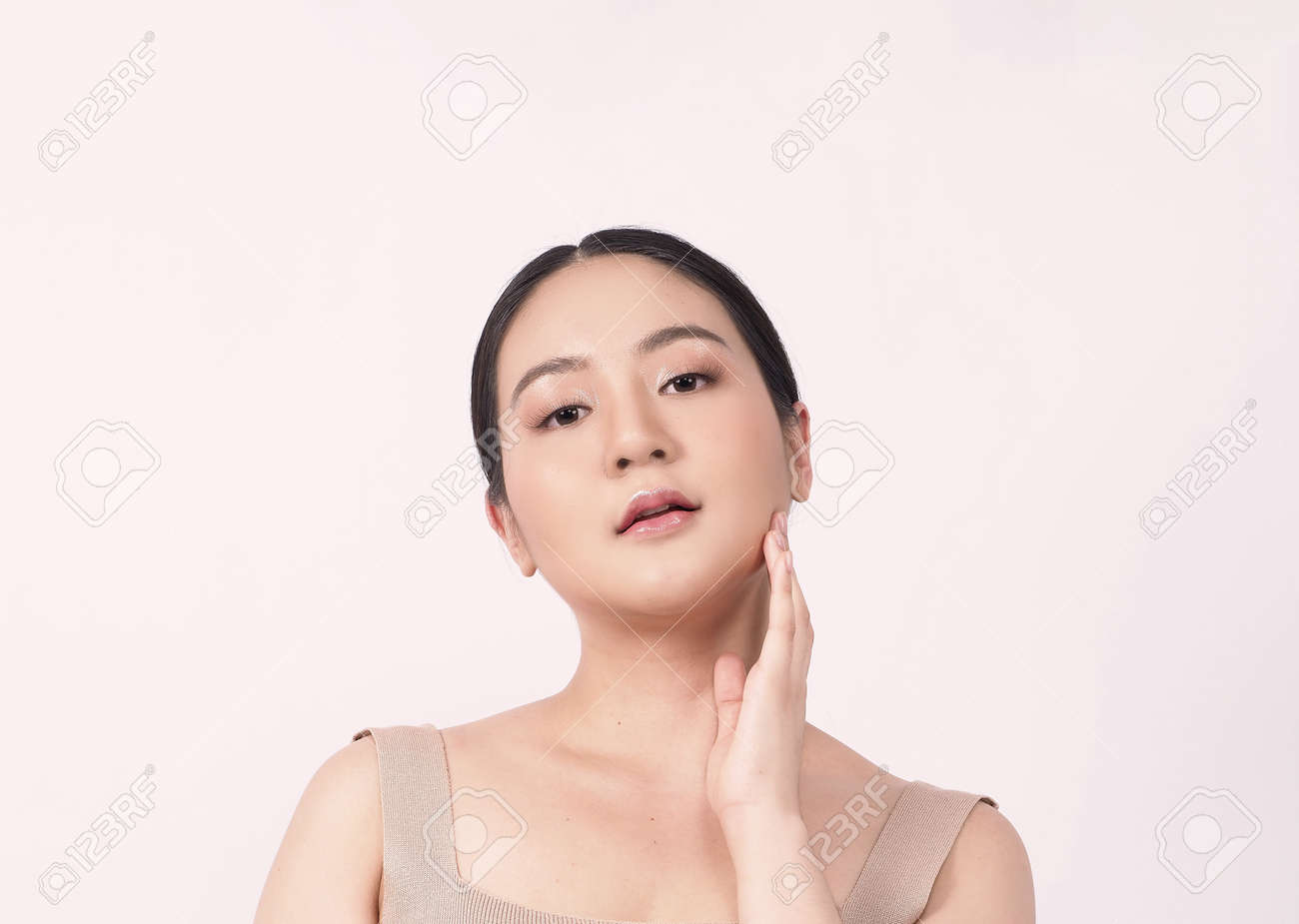 Beauty skin. makeup concept. Young pretty woman black hair and beauty face make up for skincare cosmetic. Showing delicate soft and firm and ageless facial skin. Oil type skin. Close up facial. beauty shot. - 168771741