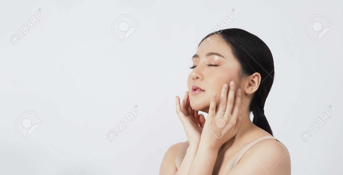 Beauty skin. makeup concept. Young pretty woman black hair and beauty face make up for skincare cosmetic. Showing delicate soft and firm and ageless facial skin. Oil type skin. Close up facial. beauty shot. - 168771747