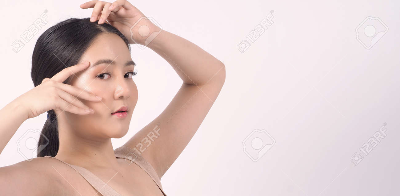 Beauty skin. makeup concept. Young pretty woman black hair and beauty face make up for skincare cosmetic. Showing delicate soft and firm and ageless facial skin. Oil type skin. Close up facial. beauty shot. - 168771751