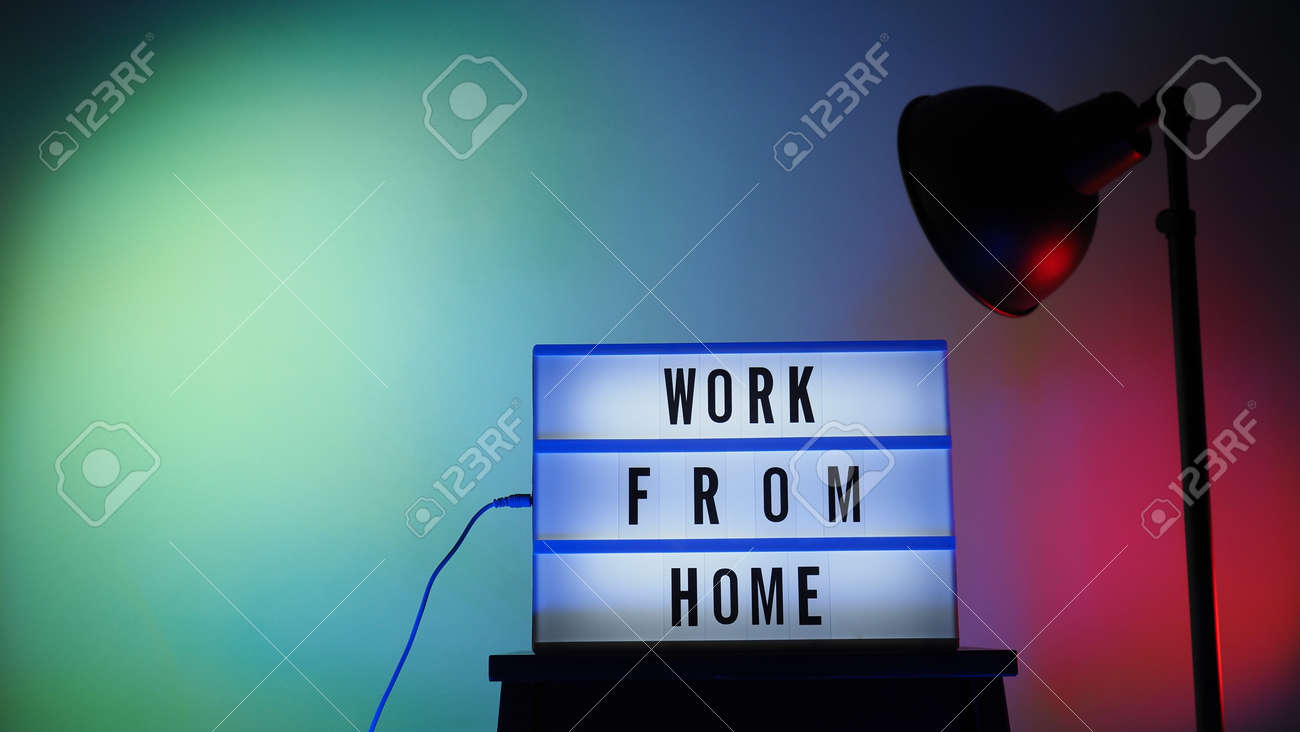 Work from home light box in studio. WFH Text on lightbox. Represent work from home for social distancing concept during coronavirus pandemic. WFH message on light board COVID 19 quarantine situation. - 168300472