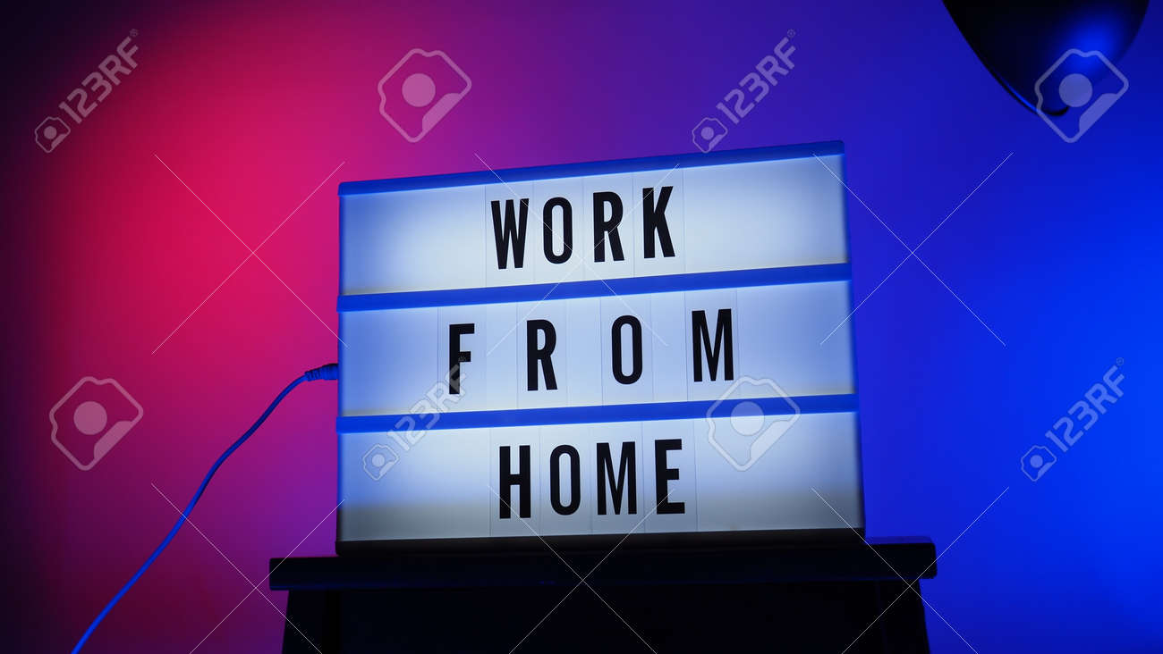 Work from home light box in studio. WFH Text on lightbox. Represent work from home for social distancing concept during coronavirus pandemic. WFH message on light board COVID 19 quarantine situation. - 168300475