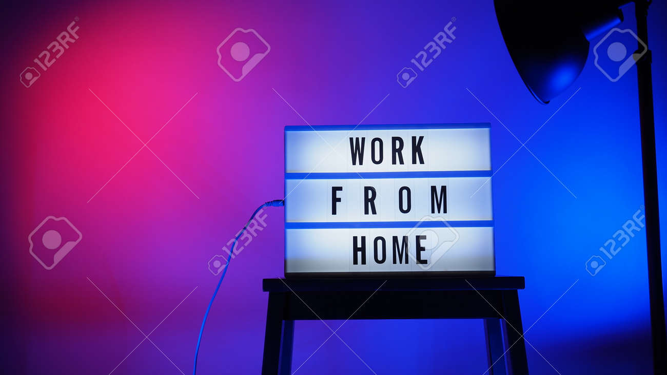 Work from home light box in studio. WFH Text on lightbox. Represent work from home for social distancing concept during coronavirus pandemic. WFH message on light board COVID 19 quarantine situation. - 168300476