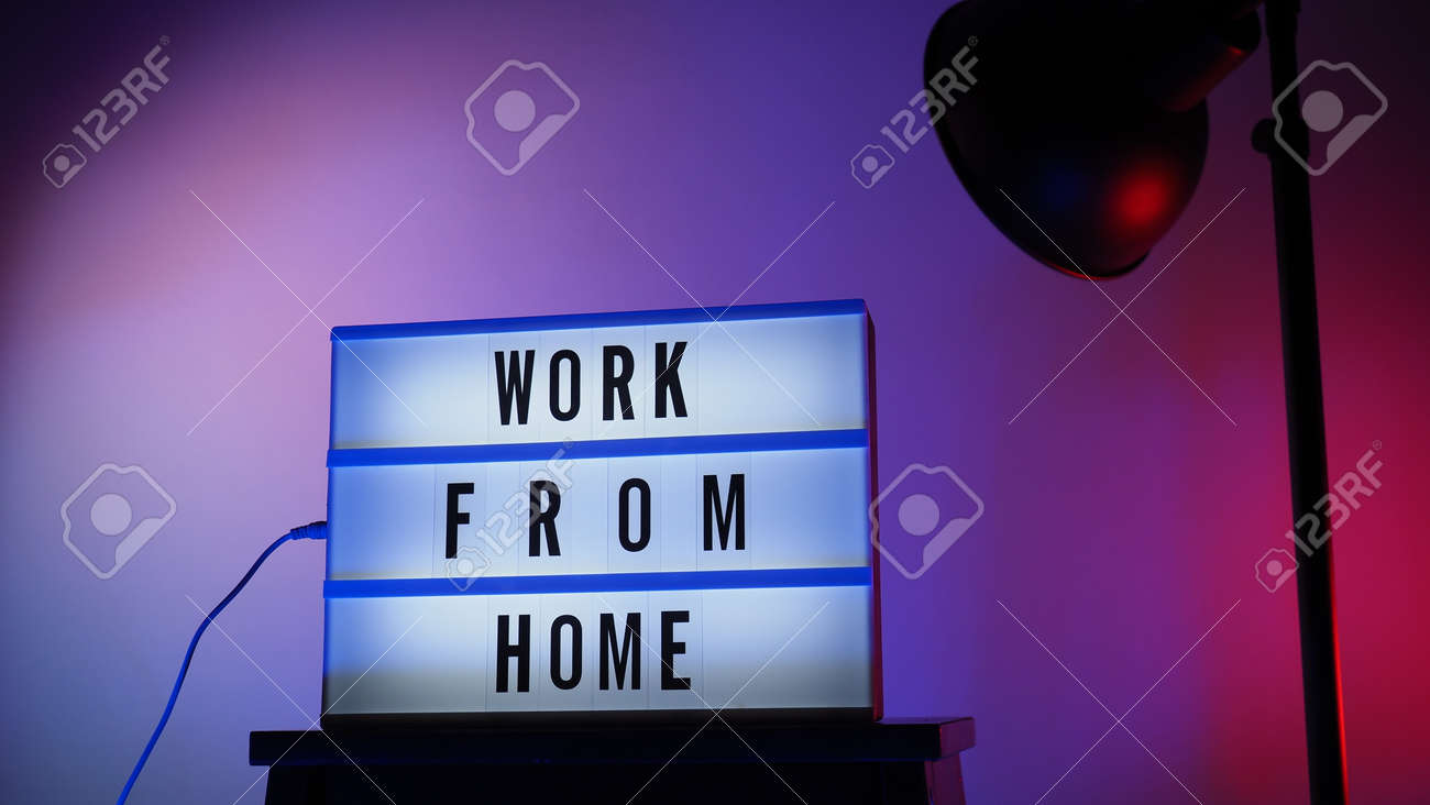 Work from home light box in studio. WFH Text on lightbox. Represent work from home for social distancing concept during coronavirus pandemic. WFH message on light board COVID 19 quarantine situation. - 168300479