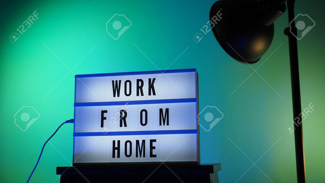 Work from home light box in studio. WFH Text on lightbox. Represent work from home for social distancing concept during coronavirus pandemic. WFH message on light board COVID 19 quarantine situation. - 168300554