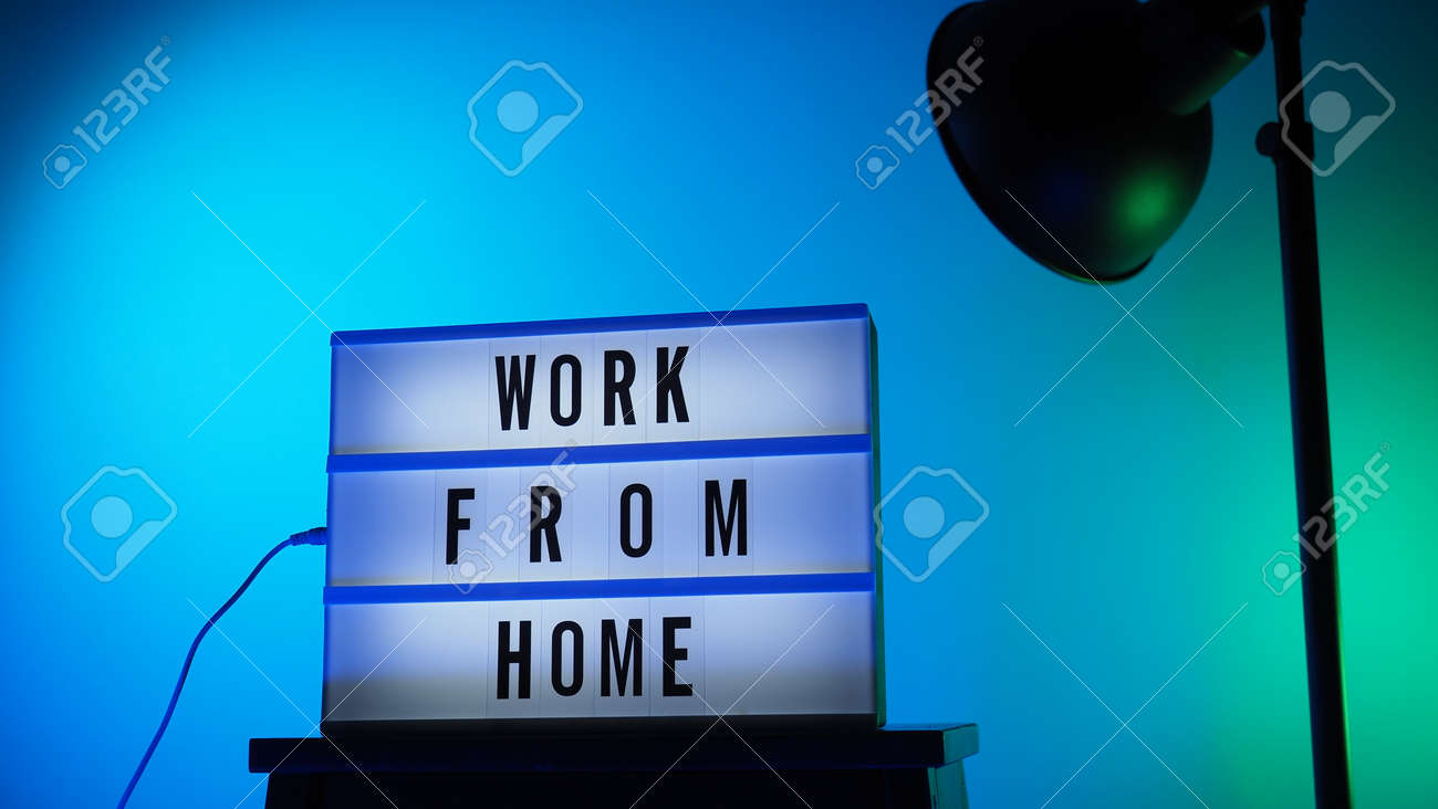 Work from home light box in studio. WFH Text on lightbox. Represent work from home for social distancing concept during coronavirus pandemic. WFH message on light board COVID 19 quarantine situation. - 168300556