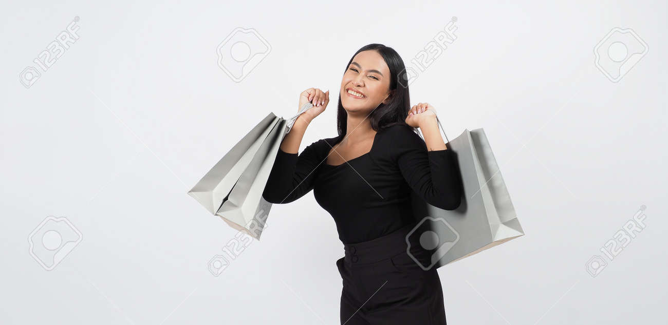 Love Shopping concept. Beautiful Asian woman carrying gray color bags shopping online. isolated on white studio background. online shopping bag. black hair woman love shopping online. Online purchase - 168300567