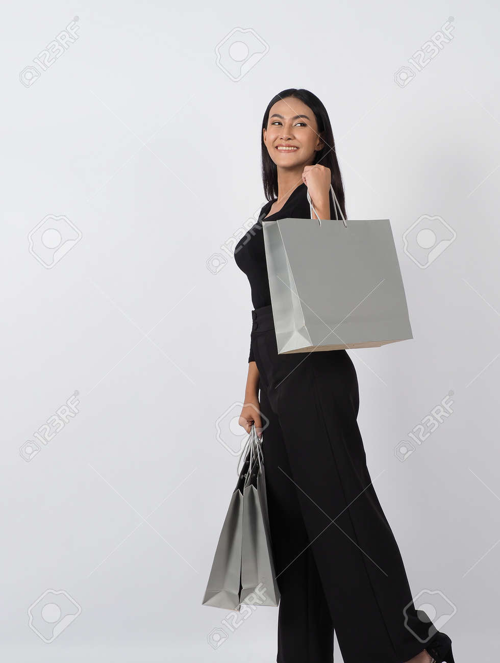 Love Shopping concept. Beautiful Asian woman carrying gray color bags shopping online. isolated on white studio background. online shopping bag. black hair woman love shopping online. Online purchase - 168300577