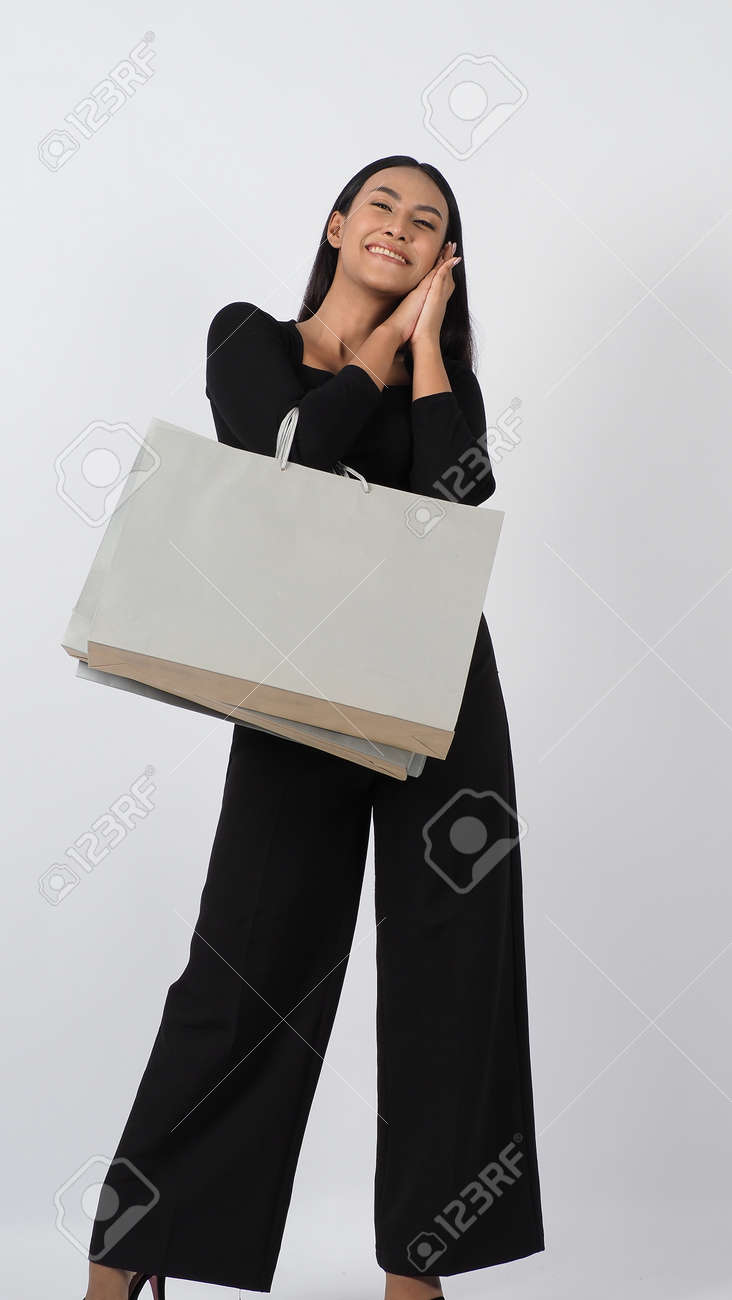 Love Shopping concept. Beautiful Asian woman carrying gray color bags shopping online. isolated on white studio background. online shopping bag. black hair woman love shopping online. Online purchase - 168301078