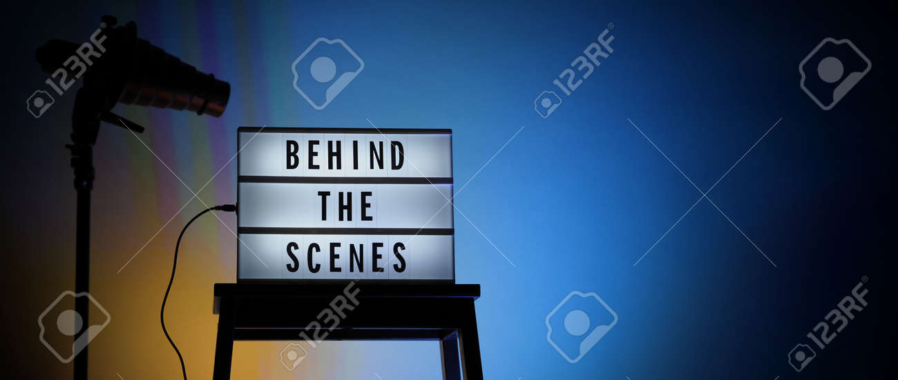 Behind the scenes letterboard text on Lightbox or Cinema Light box. Movie clapperboard megaphone and director chair beside. Background LED color change loop. static camera in video production studio. - 170416168