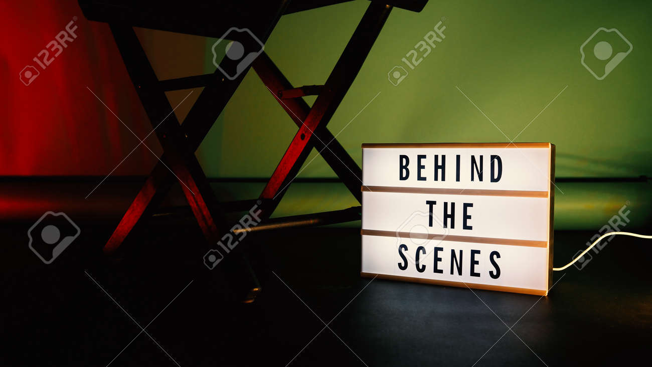 Behind the scenes letterboard text on Lightbox or Cinema Light box. Movie clapperboard megaphone and director chair beside. Background LED color change loop. static camera in video production studio. - 170416177