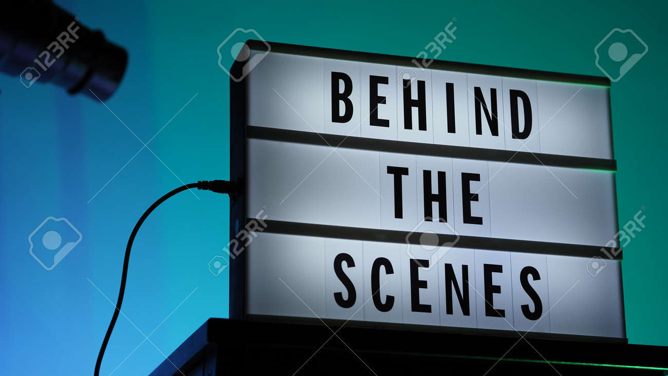 Behind the scenes letterboard text on Lightbox or Cinema Light box. Movie clapperboard megaphone and director chair beside. Background LED color change loop. static camera in video production studio. - 170416180
