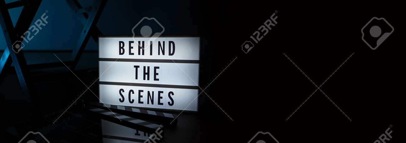 Behind the scenes letterboard text on Lightbox or Cinema Light box. Movie clapperboard megaphone and director chair beside. Background LED color change loop. static camera in video production studio. - 170416187