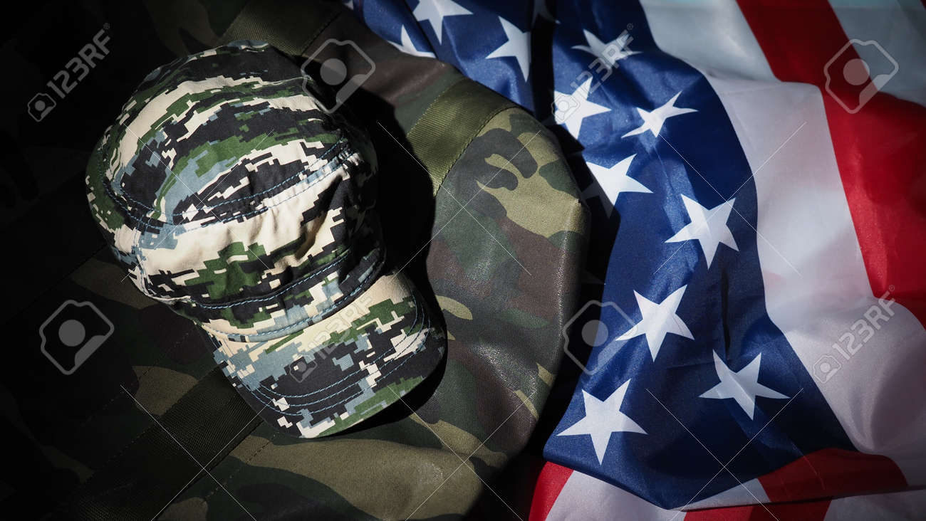 American flag and Military hat or bag. Top view angle. Soldier hat or helmet with national american flag on black background. Represent military concept by camouflage object and USA nation flag. - 170314451