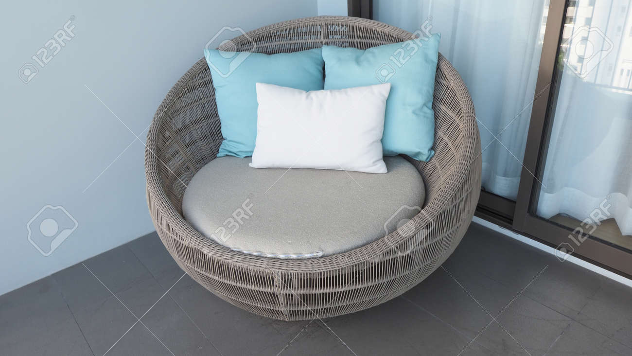 Outdoor beach chair on the hotel room balcony or terrace which made from natural wood called rattan and brown color round shape and look luxury for relaxing or sleeping or for party. - 170835218