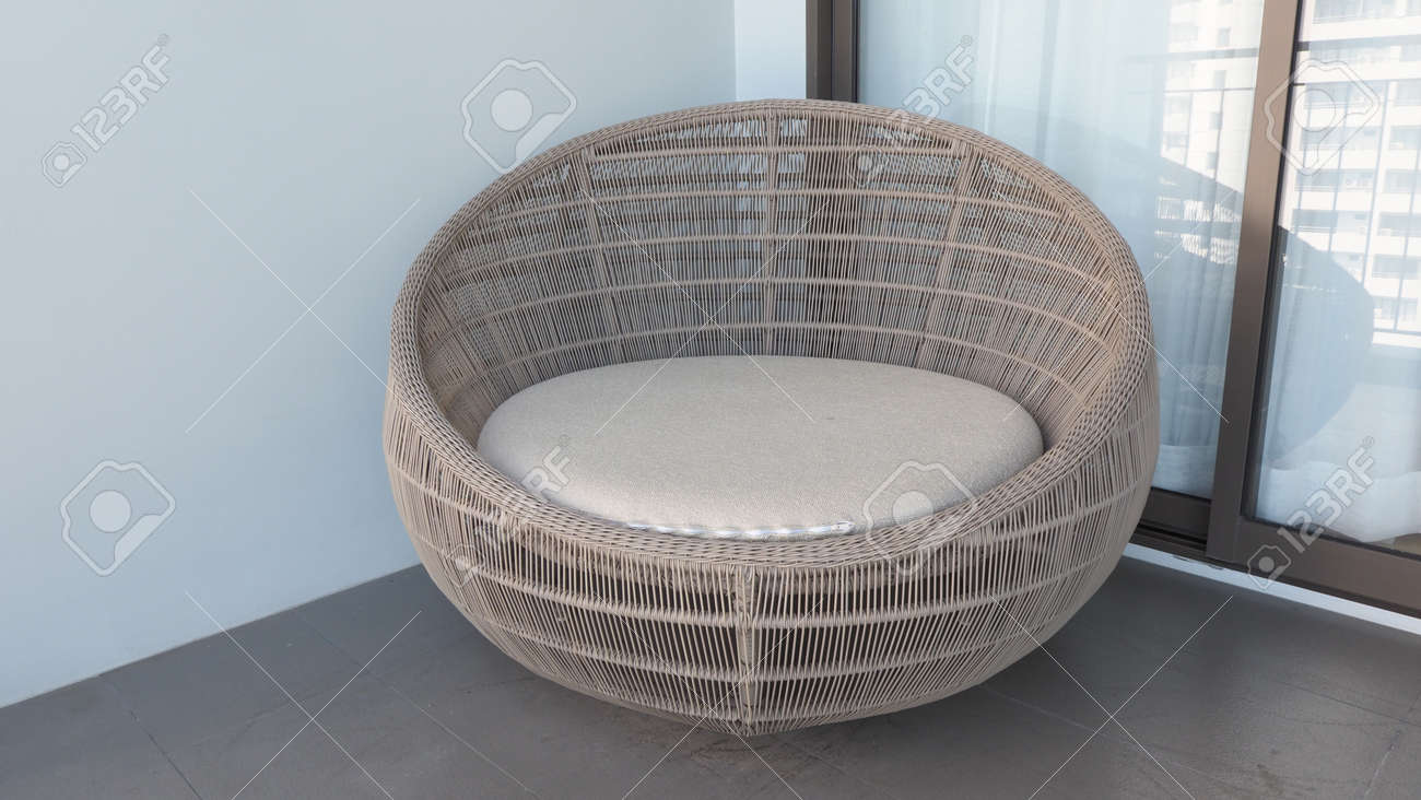 Outdoor beach chair on the hotel room balcony or terrace which made from natural wood called rattan and brown color round shape and look luxury for relaxing or sleeping or for party. - 170835224