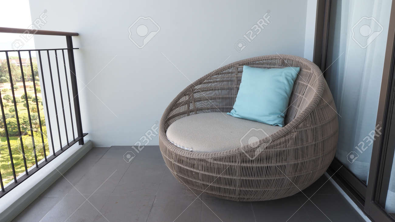 Outdoor beach chair on the hotel room balcony or terrace which made from natural wood called rattan and brown color round shape and look luxury for relaxing or sleeping or for party. - 170835152