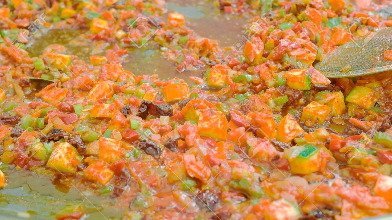 Close up shot of vegetarian food being cooked on huge pan - 56219598