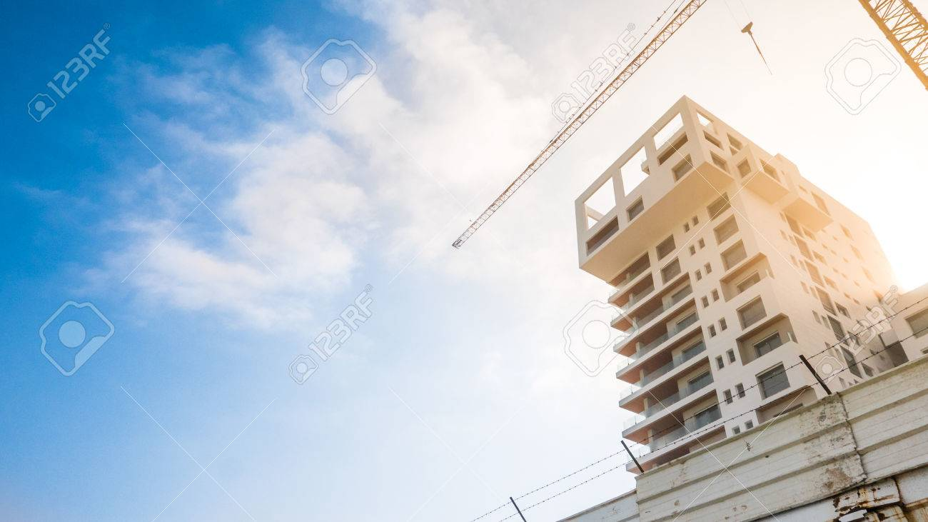 One building reaching to the sky being developed and finished up - 58641317