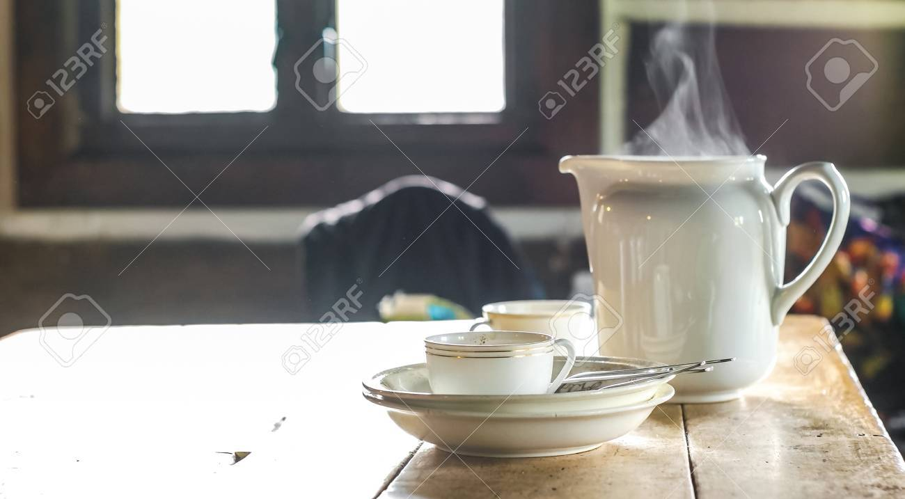 Smoke coming out of the tea pot set, genuine breakfast dishes in the travelers cabin - 60176797