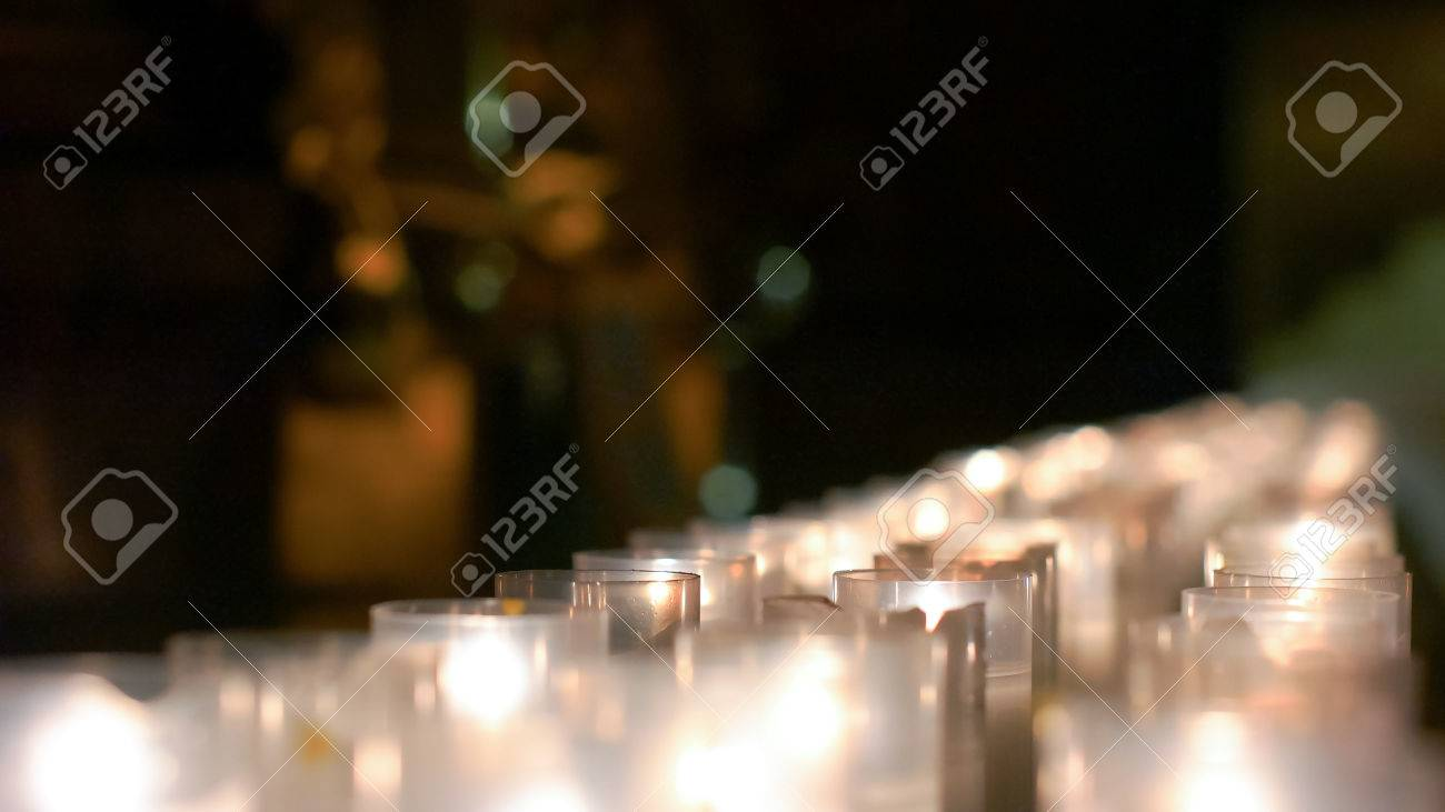 Detailed row of candles grouped together on the christian altar - 60533722