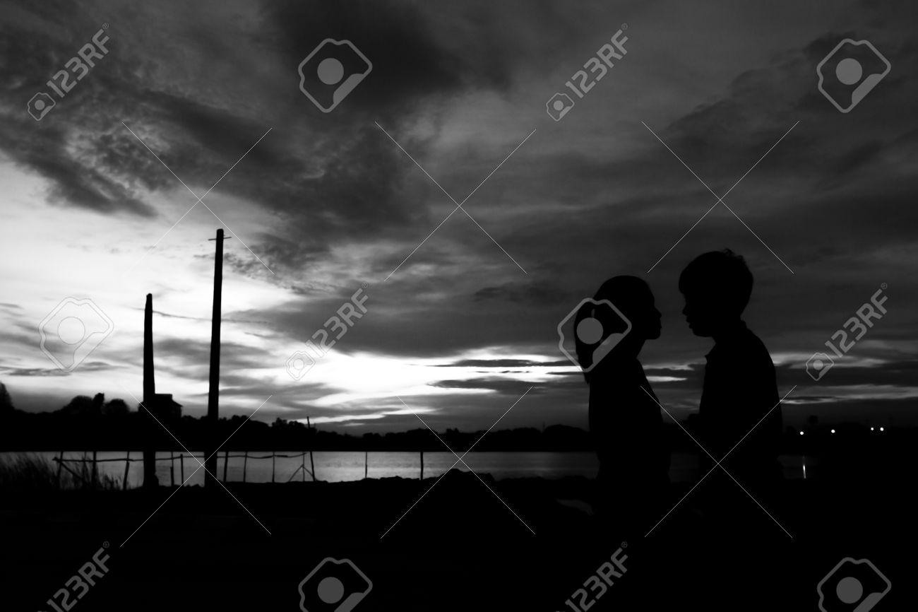 Silhouette couple kissing over sunset background,twilight , blurry, select focus,blackandwhite - 44897600