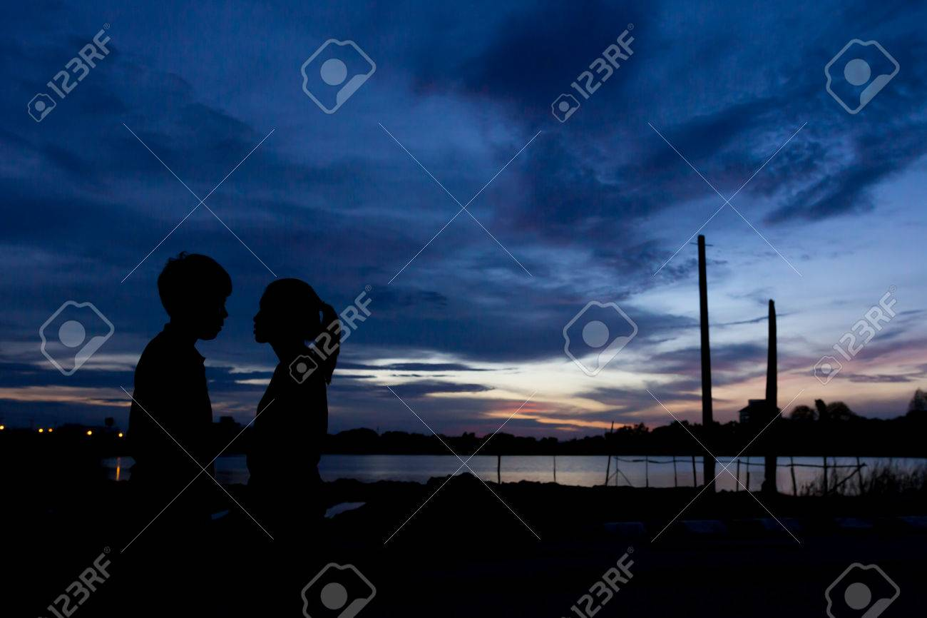 Silhouette couple kissing over sunset background,twilight , blurry, select focus - 44897602