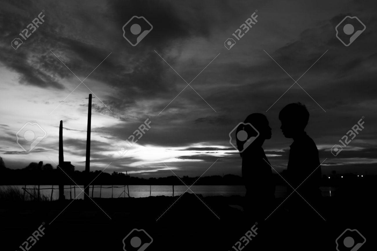 Silhouette couple kissing over sunset background,twilight , blurry, select focus,blackandwhite - 45127764