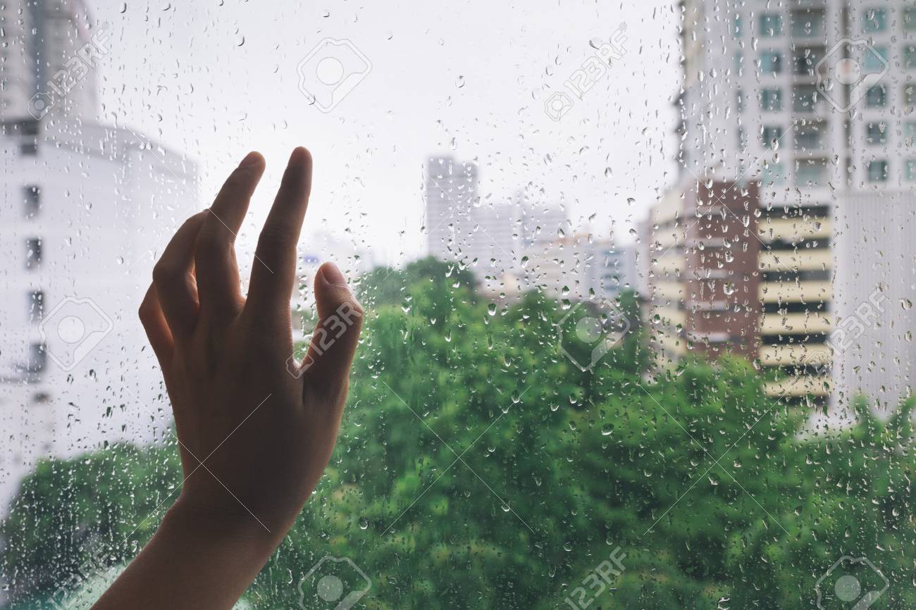 Lonely hand on the mirror during rain - 45127768