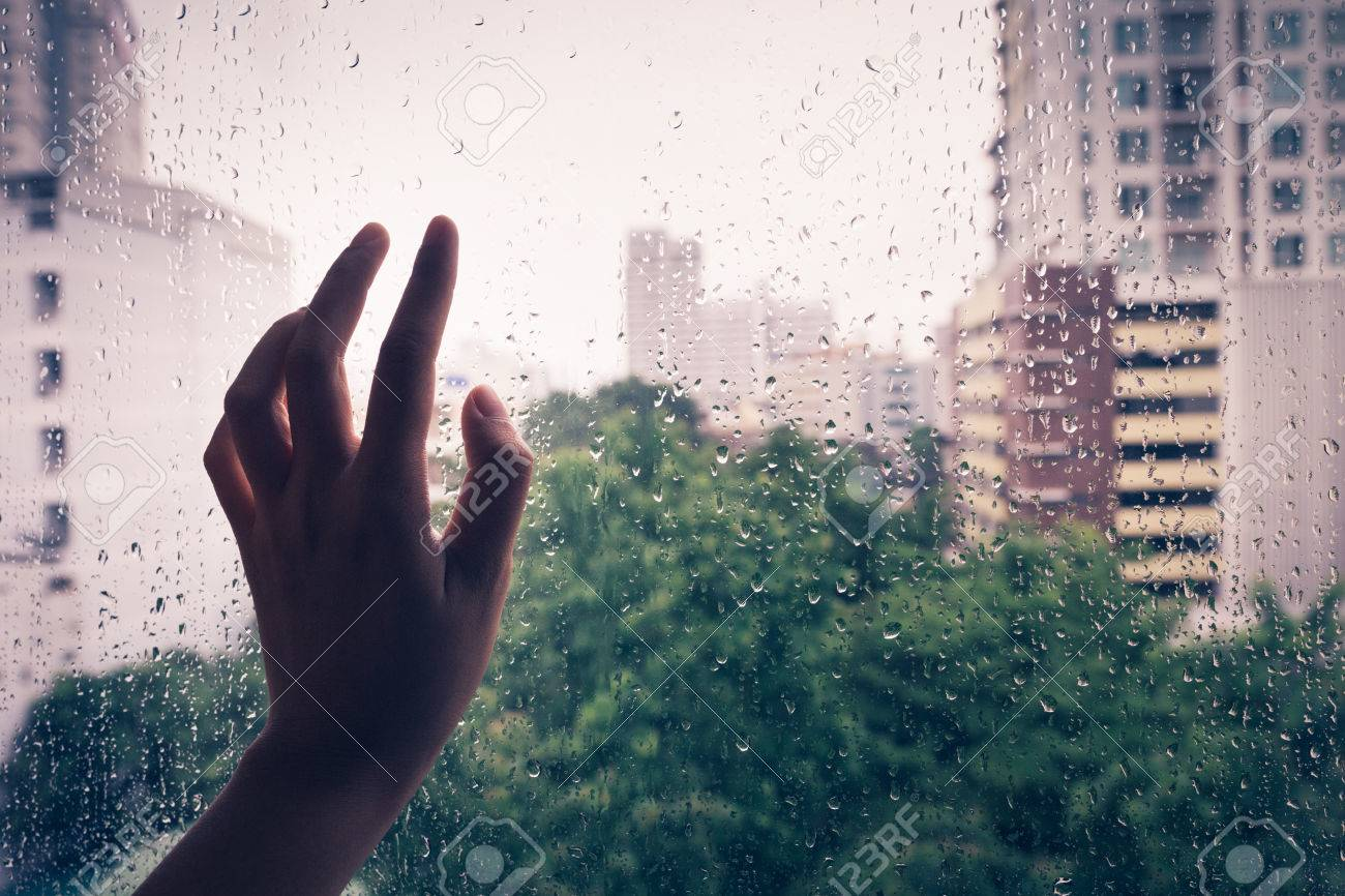 Lonely hand on the mirror during rain,vintage - 45127769