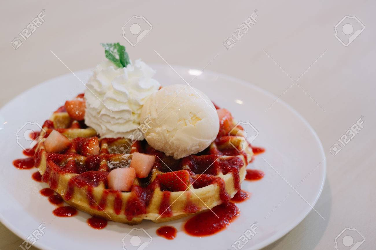 Belgian waffles with ice cream and strawberries - 60536106