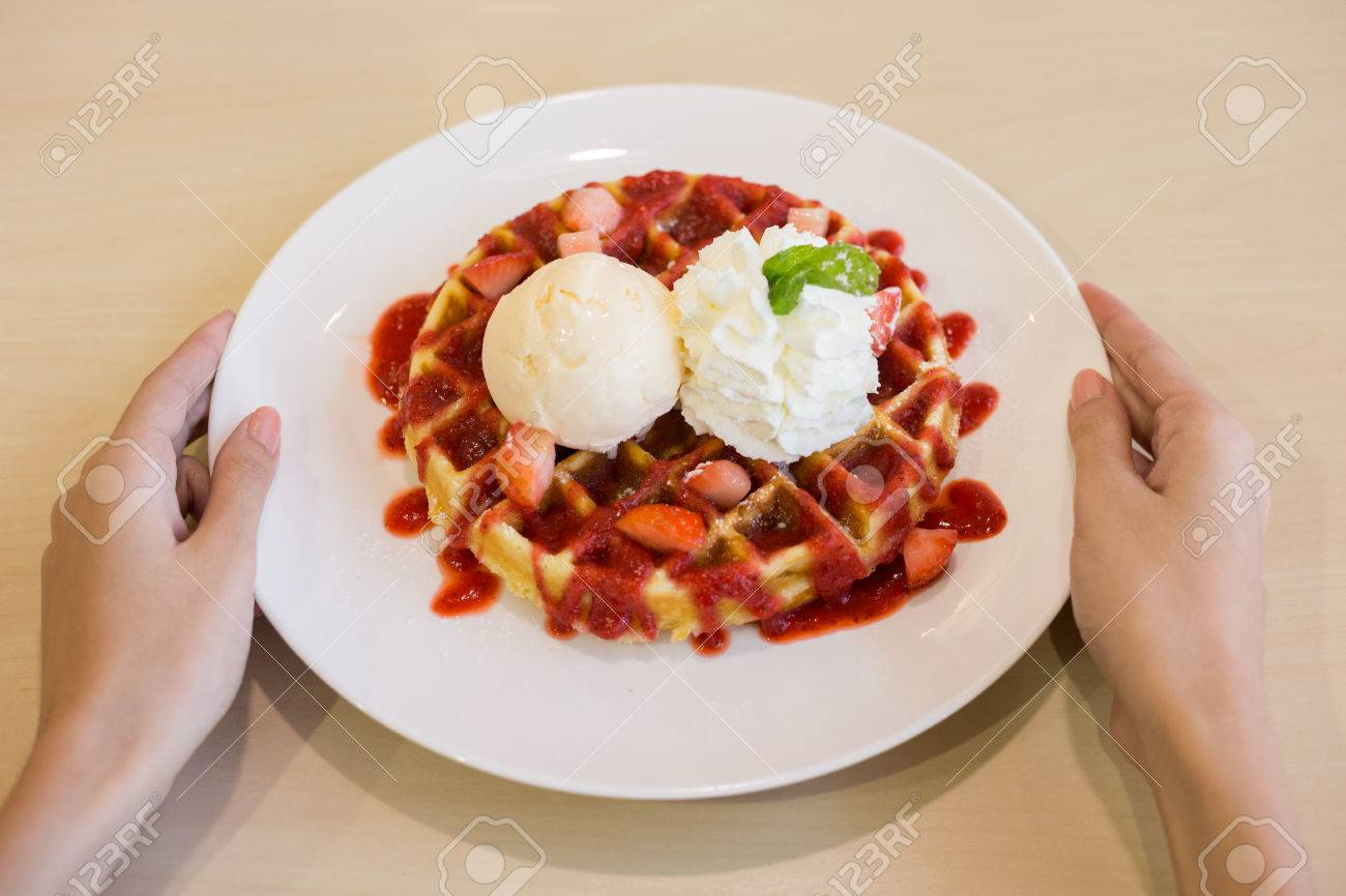 Belgian waffles with ice cream and strawberries - 60536113
