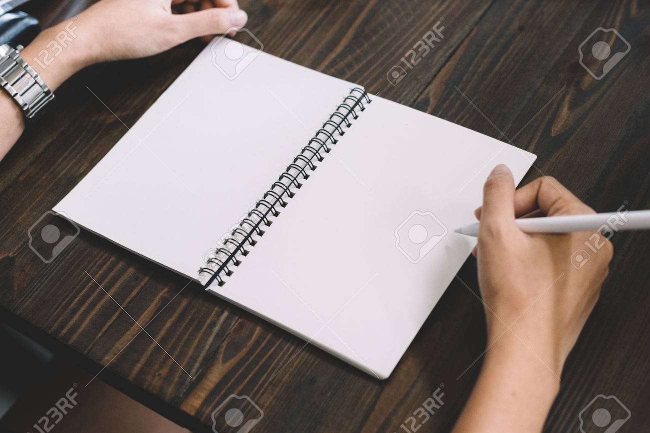 Hand write pencilin a notebook on wooden background - 60536156