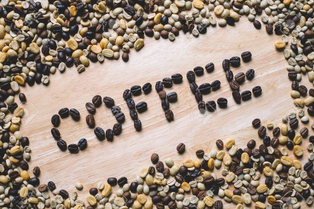 """Word of """"coffee"""" made from coffee beans on wooden background - 60536161"""