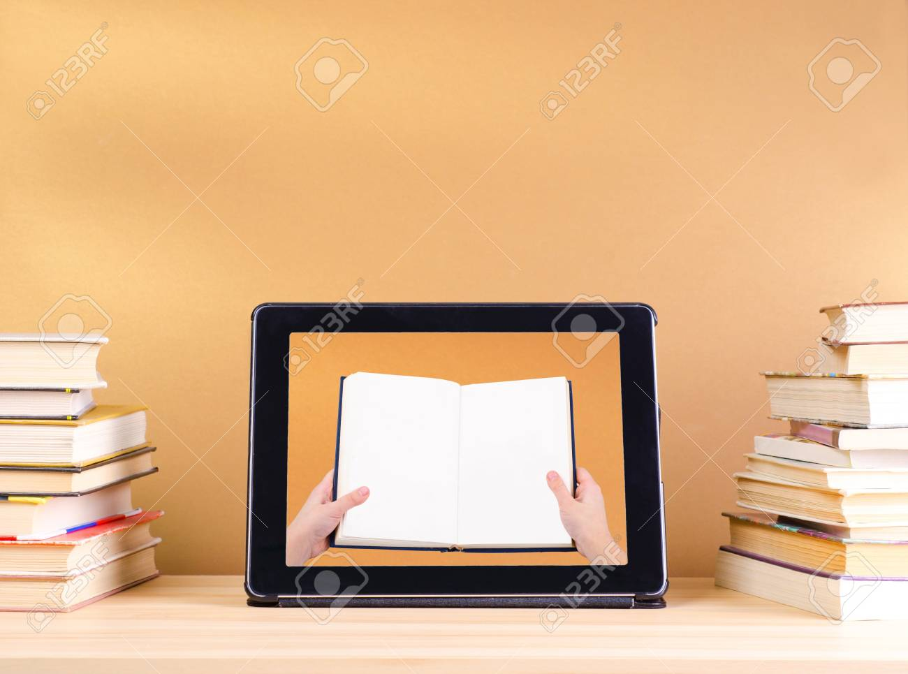 raeding book in tablet pc and stack book on wooden table Stock Photo - 17445627