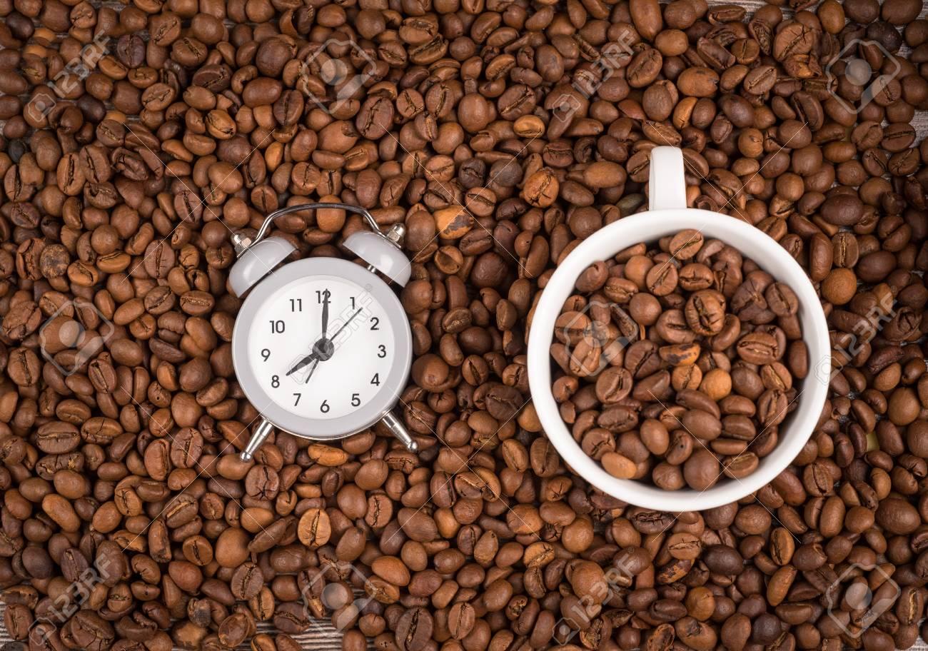 Astounding Cup Of Coffee Clock And Coffee Beans On A Table Inzonedesignstudio Interior Chair Design Inzonedesignstudiocom