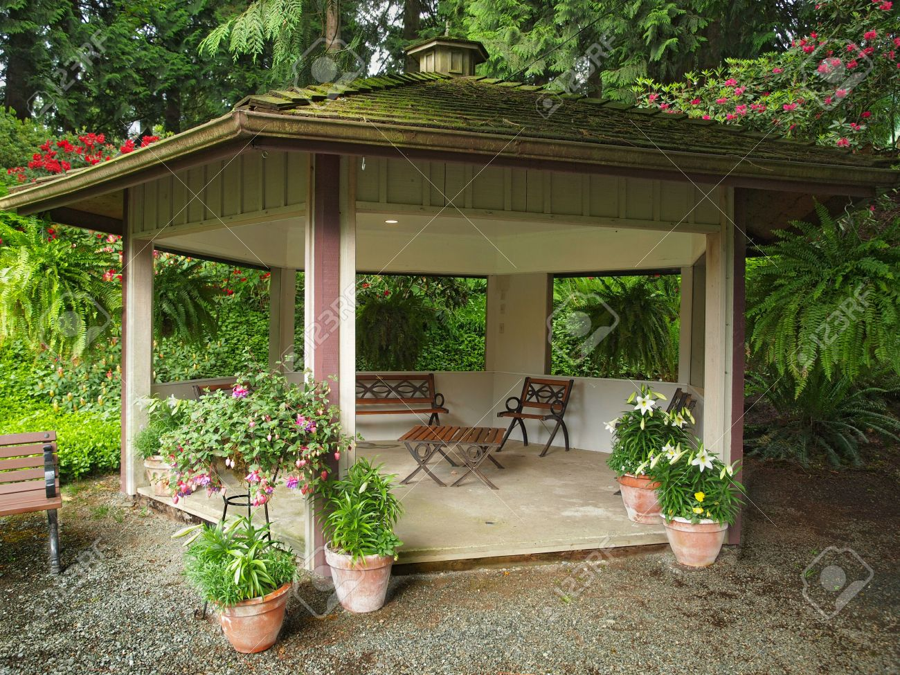 Beau Stock Photo   Woodent Gazebo With Roof Covered With Moss In The Garden