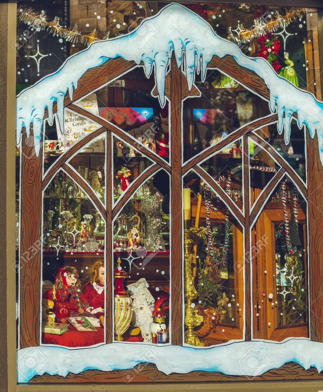 Painted store window with Christmas toys, illumination and and merchandise Stock Photo - 24495606
