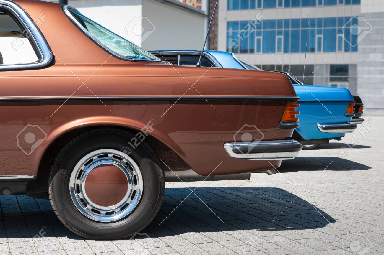 Rear View On The Vintage Cars Parked In Line. Brown Retro Classic ...