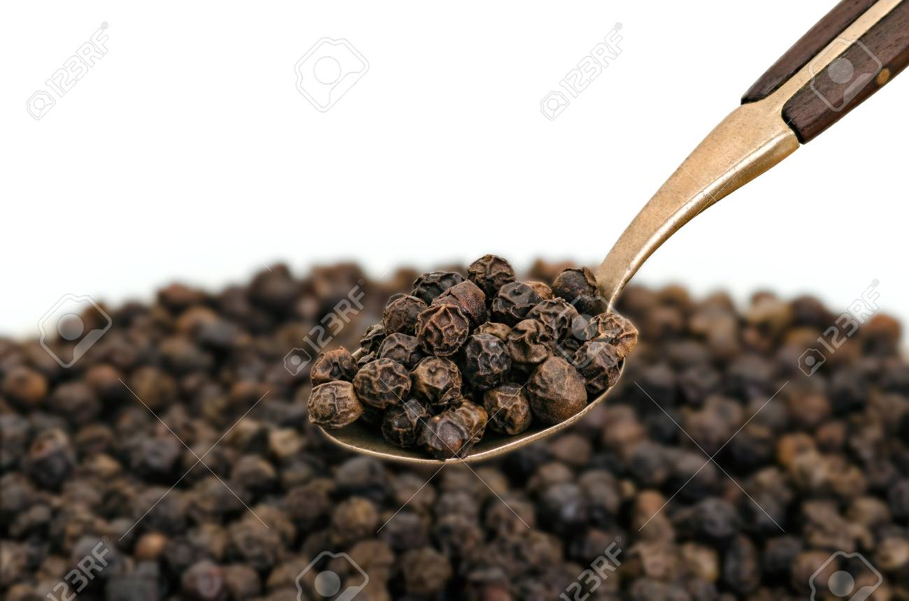 Whole Black Pepper on Old Spoon - 69898499