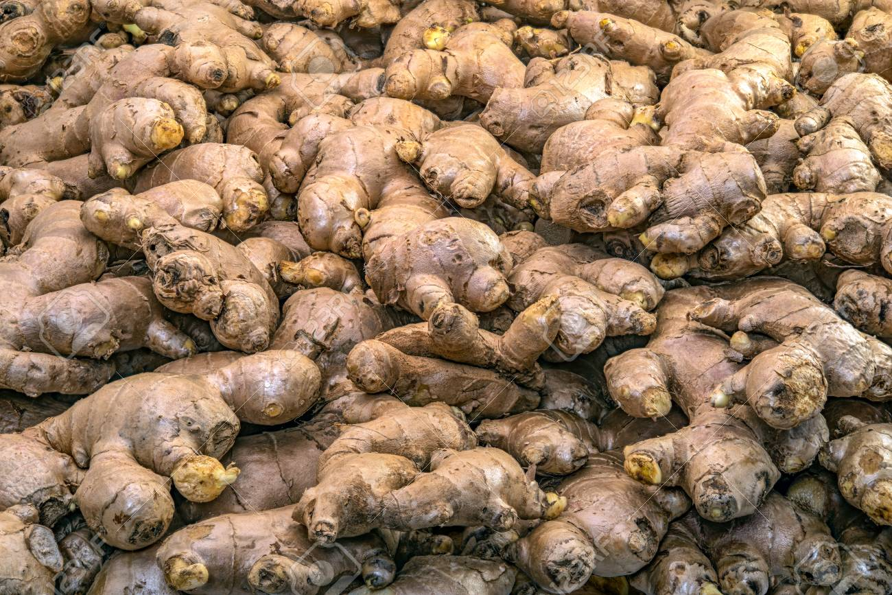 Full basket of ginger is on display for sale in the fresh vegetable market - 76912607