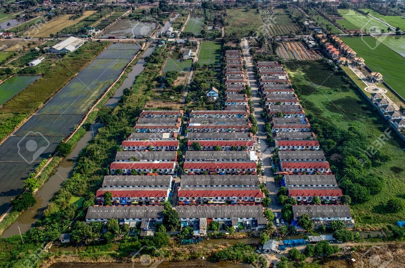 Village, housing in land development farmland in Thailand - 77649420